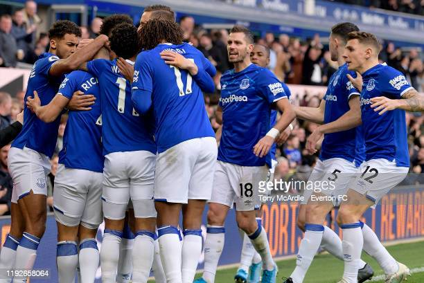 Dominic CalvertLewin Morgan Schneiderlin and Lucas Digne celebrate the goal of Richarlison during the Premier League match between Everton and...