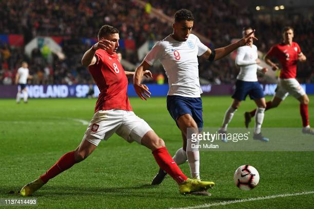 Dominic CalvertLewin of England battles for the ball with Jakub Piotrowski of Poland during the U21 International Friendly match between England and...