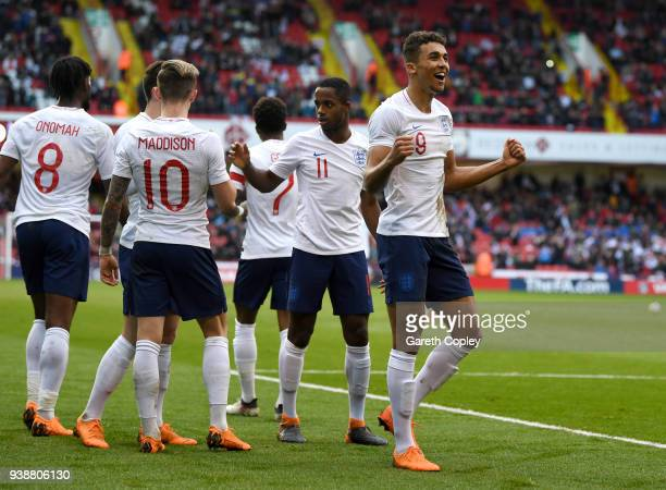 Dominic CalvertLewin of England celebrates scoring the opening goal past Andriy Lunin of Ukraine during the U21 European Championship Qualifier...