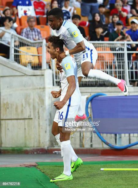 Dominic CalvertLewin of England celebrates with team mate Ademola Lookman as he scores their first goal during the FIFA U20 World Cup Korea Republic...