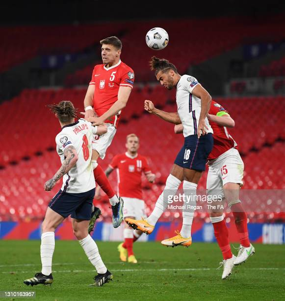 Dominic Calvert-Lewin of England competes for a header with Jan Bednarek of Poland during the FIFA World Cup 2022 Qatar qualifying match between...