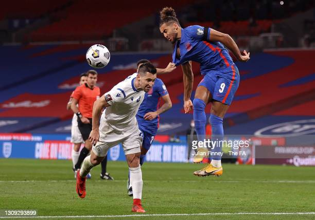 Dominic Calvert-Lewin of England has his shirt pulled by Dante Carlos Rossi of San Marino during the FIFA World Cup 2022 Qatar qualifying match...