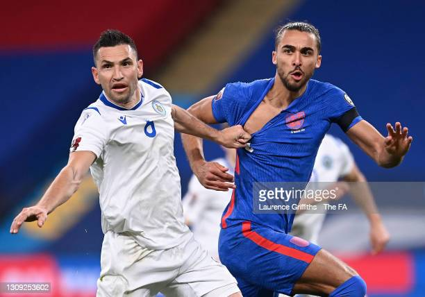 Dominic Calvert-Lewin of England has his shirt ripped off by Dante Rossi of San Marino during the FIFA World Cup 2022 Qatar qualifying match between...