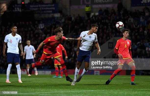 Dominic CalvertLewin of England is pulled back by Albert Alavedra of Andorra during the 2019 UEFA European Under21 Championship Qualifier between...