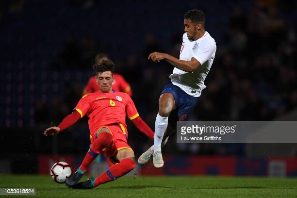 Dominic CalvertLewin of England is tackled by Christian Garcia of Andorra during the 2019 UEFA European Under21 Championship Qualifier between...