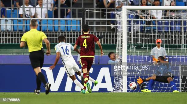 Dominic CalvertLewin of England scores their first goal past goalkeeper Wuilker Farinez of Venezuela during the FIFA U20 World Cup Korea Republic...