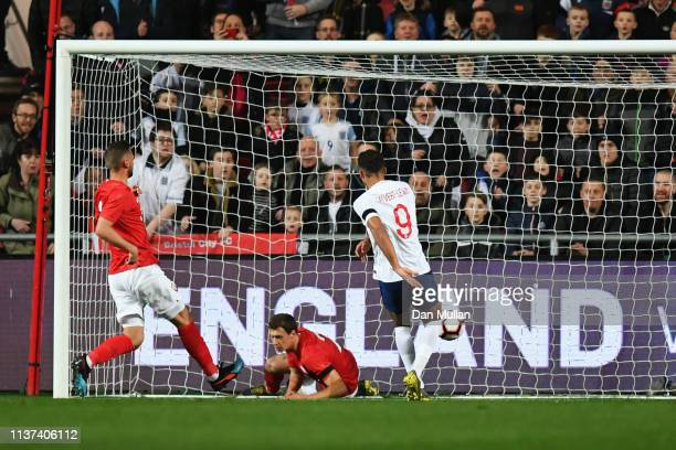 Dominic CalvertLewin of England shoots and scores the first goal of the game during the U21 International Friendly match between England and Poland...