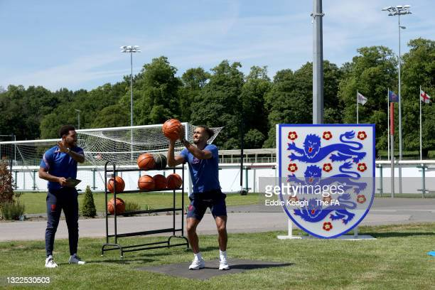Dominic Calvert-Lewin of England throws a basketball with presenter Josh Denzel at St George's Park on June 08, 2021 in Burton upon Trent, England.
