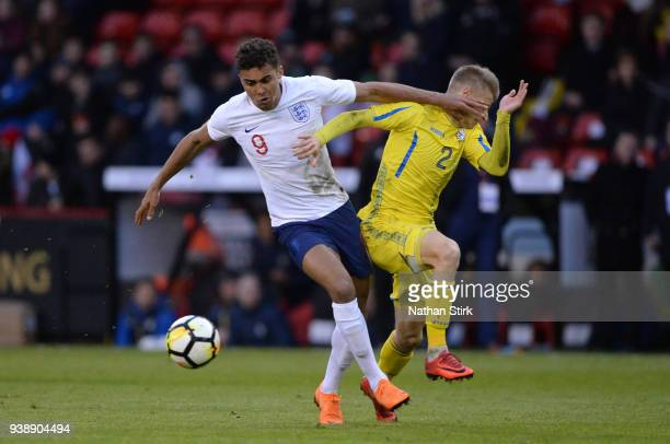 Dominic CalvertLewin of England U21 and Pavlo Lukyanchuk of Ukraine U21 in action during the U21 European Championship Qualifier match between...