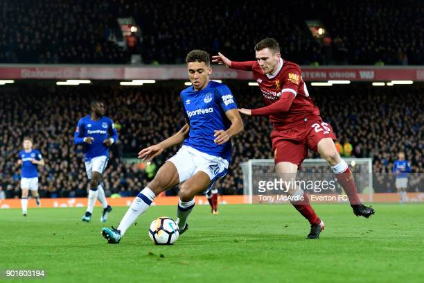 Dominic CalvertLewin of Everton and Andrew Robertson challenge for the ballduring The Emirates FA Cup Third Round match between Liverpool and Everton...