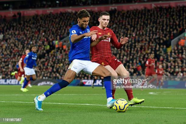 Dominic CalvertLewin of Everton and Andrew Robertson of Liverpool challenge for the ball during the Premier League match between Liverpool and...