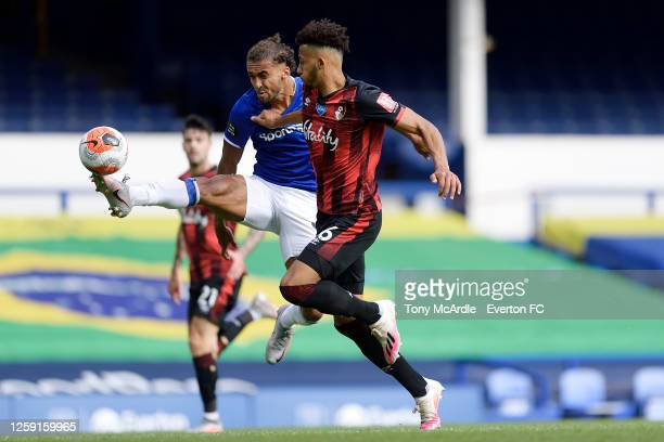 Dominic CalvertLewin of Everton and Andrew Surman challenge for the ball during the Premier League match Everton and AFC Bournemouth at Goodison Park...