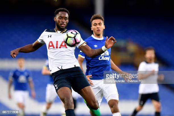 Dominic CalvertLewin of Everton and Christian Maghoma challenge for the ball during the Premier League 2 match between Everton U23 and Tottenham...