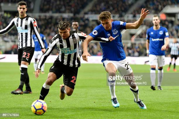 Dominic CalvertLewin of Everton and DeAndre Yedlin challenge for the ball during the Premier League match between Newcastle United and Everton at St...