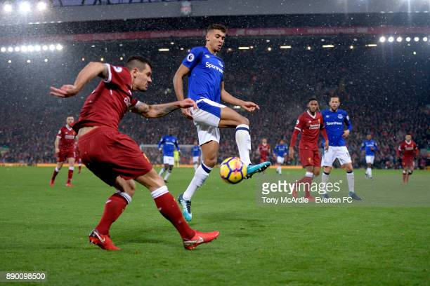Dominic CalvertLewin of Everton and Dejan Lovren challenge for the ball during the Premier League match between Liverpool and Everton at Anfield on...