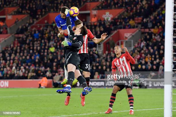 Dominic CalvertLewin of Everton and goalkeeper Alex McCarthy challenge for the ball during the Premier League match between Southampton FC and...