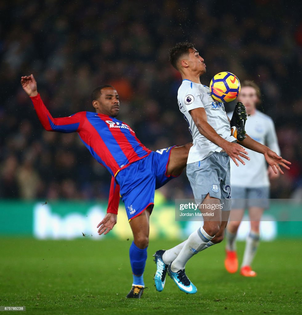 Dominic Calvert-Lewin of Everton and Jason Puncheon of Crystal Palace compete for the ball during the Premier League match between Crystal Palace and Everton at Selhurst Park on November 18, 2017 in London, England.