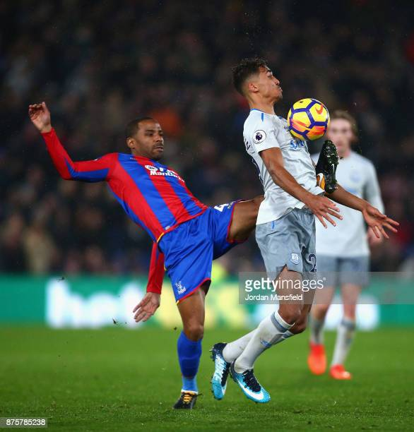 Dominic CalvertLewin of Everton and Jason Puncheon of Crystal Palace compete for the ball during the Premier League match between Crystal Palace and...