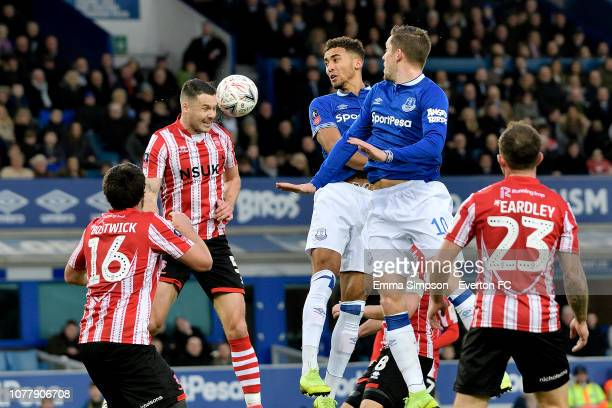 Dominic Calvert-Lewin of Everton and Jason Shackell head the ball during the Emirates FA Cup Third Round match between Everton and Lincoln City at...