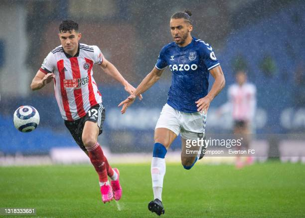 Dominic Calvert-Lewin of Everton and John Egan of Sheffield United chase the ball during the Premier League match between Everton and Sheffield...