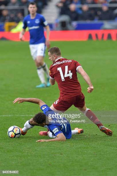 Dominic CalvertLewin of Everton and Jordan Henderson of Liverpool challenge for the ball during the Premier League match between Everton and...