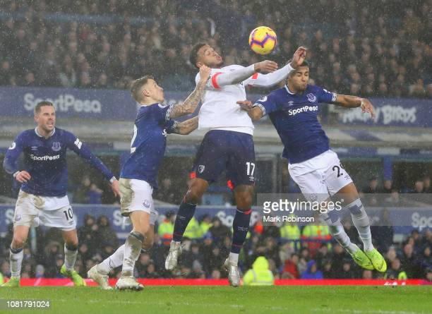 Dominic CalvertLewin of Everton and Joshua King of AFC Bournemouth jump for a header during the Premier League match between Everton FC and AFC...