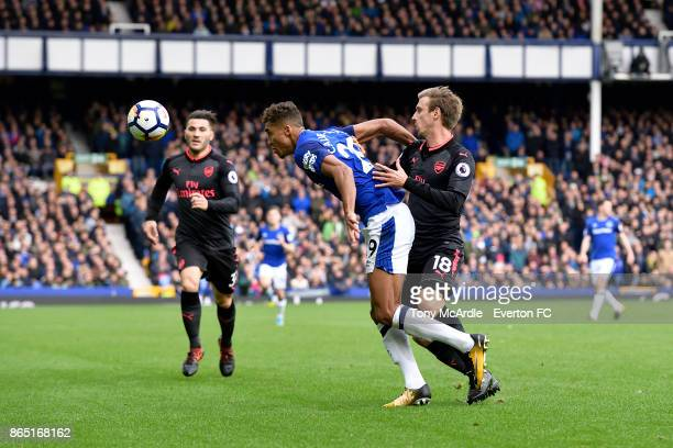 Dominic CalvertLewin of Everton and Nacho Monreal challenge for the ball during the Premier League match between Everton and Arsenal at Goodison Park...