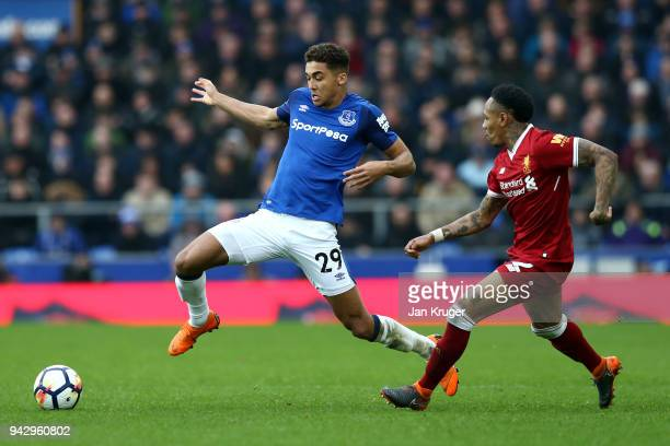 Dominic CalvertLewin of Everton and Nathaniel Clyne of Liverpool battle for possession during the Premier League match between Everton and Liverpool...