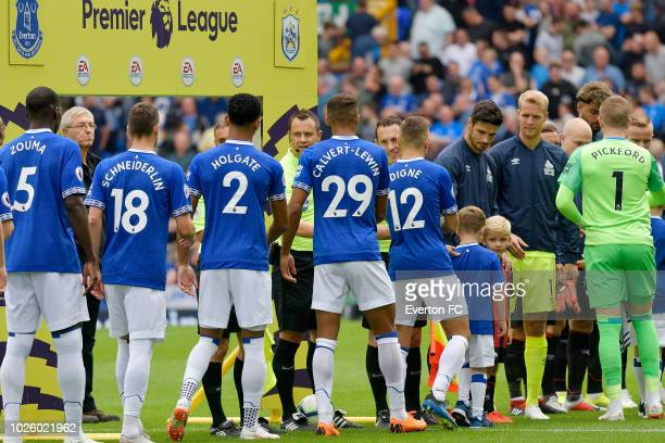 Dominic CalvertLewin of Everton and team mates shake hands with the referee during the Premier League match between Everton and Huddersfield Town at...