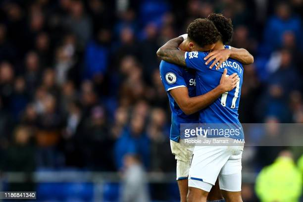 Dominic CalvertLewin of Everton and Theo Walcott of Everton celebrate at full time during the Premier League match between Everton FC and Chelsea FC...