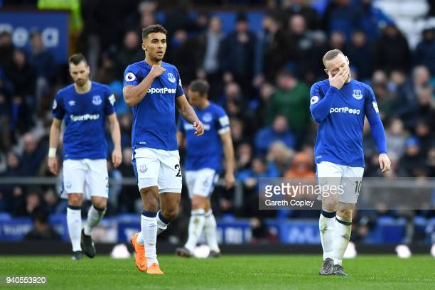 Dominic CalvertLewin of Everton and Wayne Rooney of Everton look dejected during the Premier League match between Everton and Manchester City at...