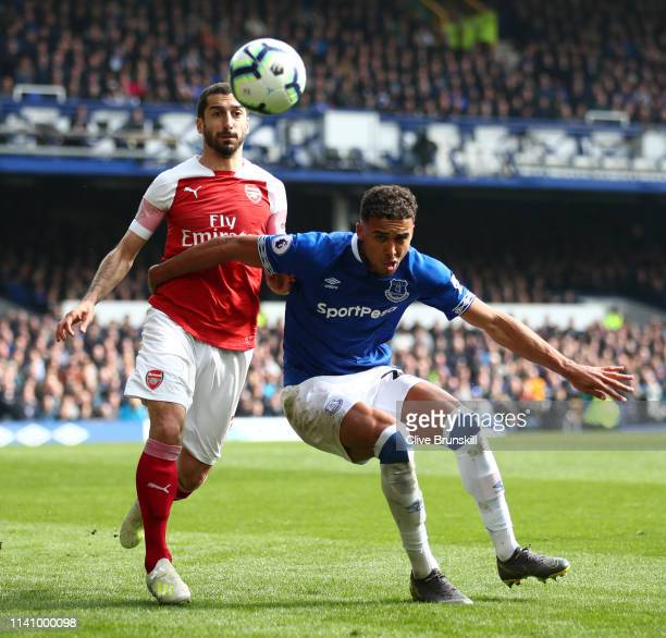 Dominic CalvertLewin of Everton attempts to hold off Henrikh Mkhitaryan of Arsenal during the Premier League match between Everton FC and Arsenal FC...