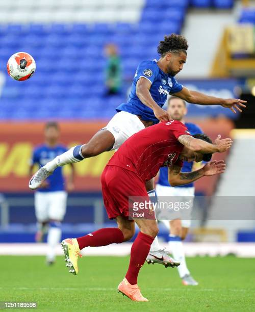 Dominic CalvertLewin of Everton battles for possession with Dejan Lovren of Liverpool during the Premier League match between Everton FC and...