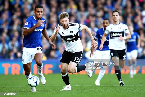 Dominic CalvertLewin of Everton battles for possession with Tim Ream of Fulham during the Premier League match between Everton FC and Fulham FC at...