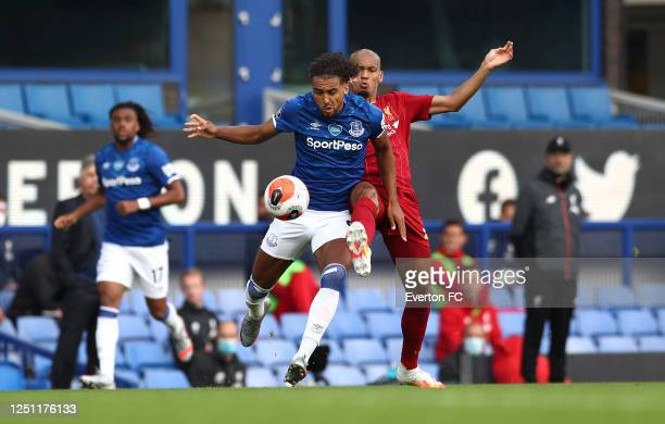 Dominic CalvertLewin of Everton battles with Fabinho of Liverpool during the Premier League match between Everton FC and Liverpool FC at Goodison...