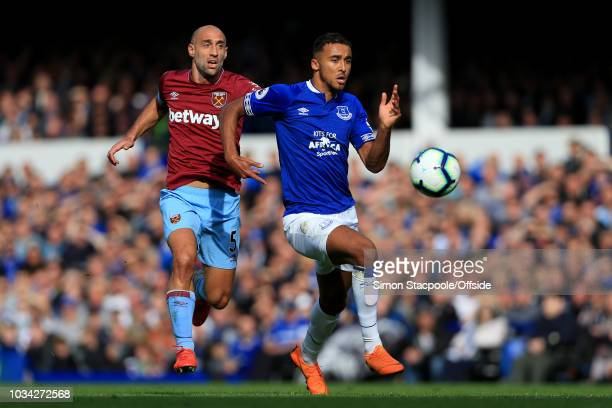 Dominic CalvertLewin of Everton battles with Pablo Zabaleta of West Ham during the Premier League match between Everton and West Ham United at...