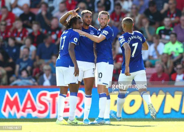 Dominic CalvertLewin of Everton celebrates after scoring his team's first goal with team mates Alex Iwobi Gylfi Sigurdsson and Richarlison during the...