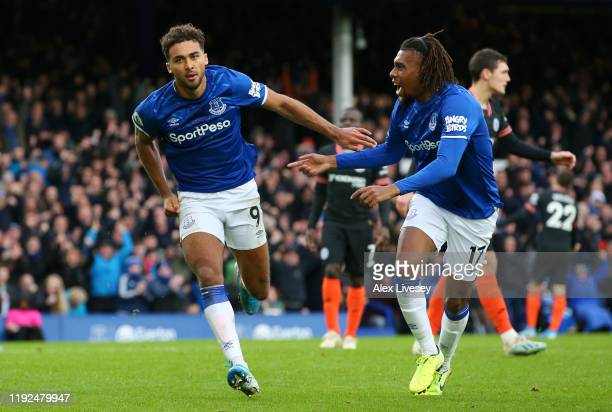 Dominic CalvertLewin of Everton celebrates after scoring his team's second goal with Alex Iwobi of Everton during the Premier League match between...