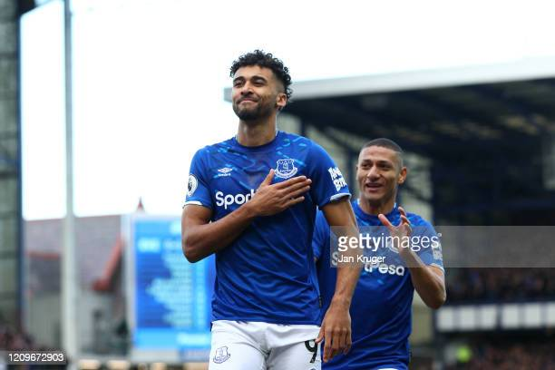 Dominic CalvertLewin of Everton celebrates after scoring his team's first goal with teammate Richarlison during the Premier League match between...