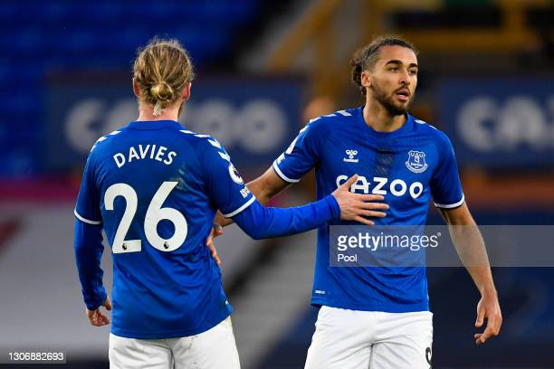 Dominic Calvert-Lewin of Everton celebrates after scoring their team's first goal with teammate Tom Davies during the Premier League match between...