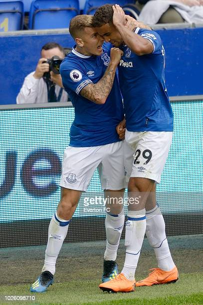 Dominic CalvertLewin of Everton celebrates his goal with Lucas Digne during the Premier League match between Everton and Huddersfield Town at...