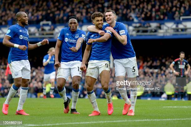 Dominic CalvertLewin of Everton celebrates his goal with Michael Keane Yerry Mina and Djibril Sidibe during the Premier League match between Everton...