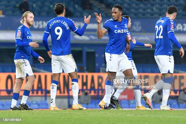 Dominic Calvert-Lewin of Everton celebrates his goal with Tom Davies and Yerry Mina during the FA Cup Fifth Round match between Everton and Tottenham...