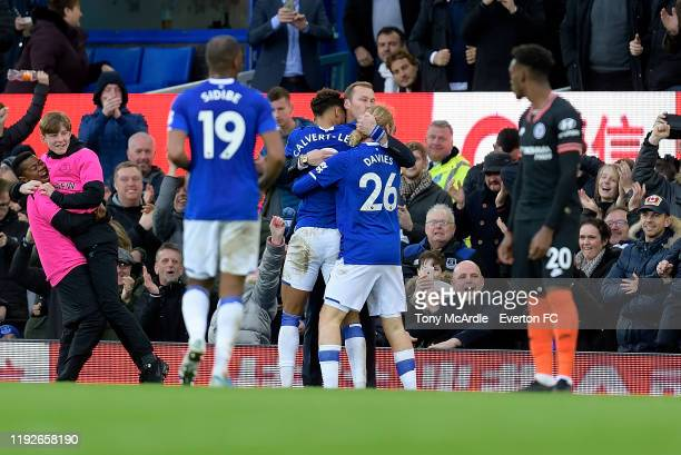 Dominic CalvertLewin of Everton celebrates his second goal with Duncan Ferguson and Tom Davies as club ballboys embrace to the left during the...