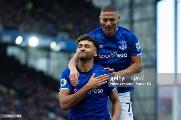 Dominic Calvert-Lewin of Everton celebrates scoring is teams first goal with team mate Richarlison during the Premier League match between Everton FC...