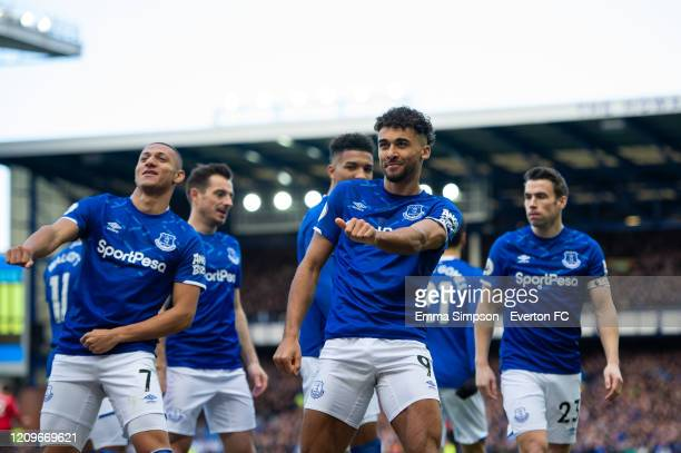 Dominic Calvert-Lewin of Everton celebrates scoring is teams first goal with team mates during the Premier League match between Everton FC and...