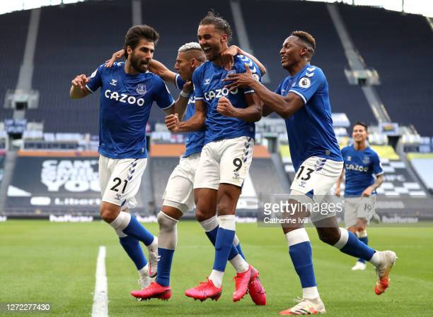Dominic Calvert-Lewin of Everton celebrates with Andre Gomes, Richarlison and Yerry Mina of Everton after scoring his team's first goal during the...