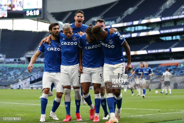 Dominic CalvertLewin of Everton celebrates with Andre Gomes Richarlison James Rodriguez and Yerry Mina of Everton after scoring his team's first goal...