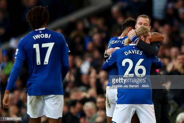 Dominic CalvertLewin of Everton celebrates with Duncan Ferguson the interim head coach / manager of Everton and Tom Davies of Everton after scoring a...