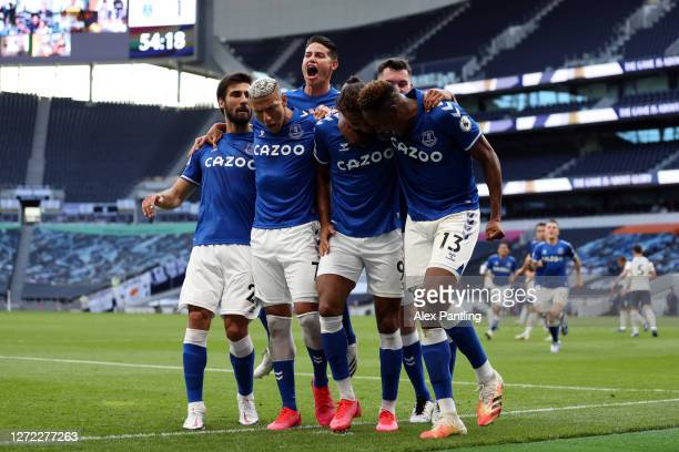 Dominic CalvertLewin of Everton celebrates with his team mates after scoring his team's first goal during the Premier League match between Tottenham...